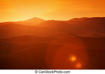 Tuscany landscape at sunrise, Italy. Tuscan hills, sun flare