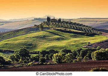 Tuscany landscape at sunrise. Tuscan farm house, green hills.