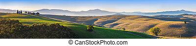 Tuscany landscape panorama at sunrise with a chapel of Madonna di Vitaleta, Italy.
