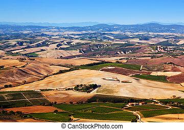 Tuscany landscape panorama, Italy. Farm houses, vineyards.