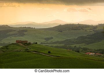 Tuscany landscape with farmhouse and yellow sky, Pienza,...