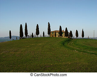 tuscany - house on a hill with cypresses