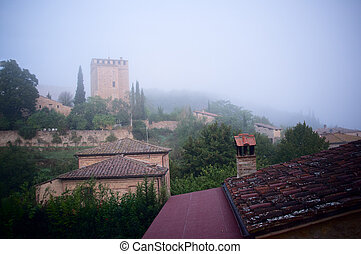 Tuscany town. - Cozy small town in Italy in a fog. View from...