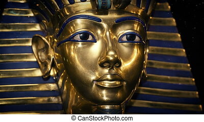 Tutankhamun Golden Mask With Dust Particles Floating