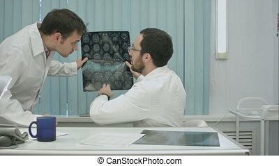 Tutor doctor help intern with x-ray, consult and gives...