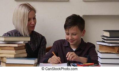 Tutor teaches a school Boy