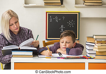 Tutor teaches a school Boy with his studies.