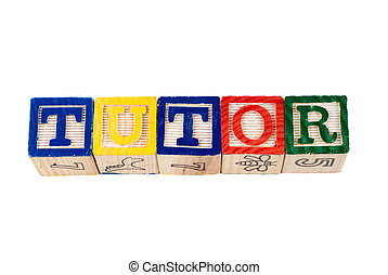 Tutor - The word tutor, spelled using wooden letter blocks,...