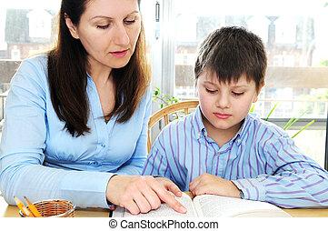 Tutoring - Teacher or tutor helping school boy to study