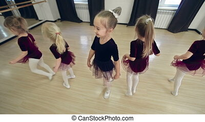 Tutu Dance - High angle of five sweet girls in tutu having...