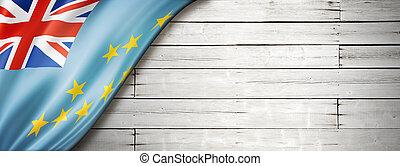 Tuvalu flag on old white wall banner