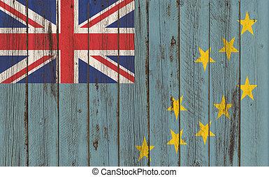 tuvalu Flag on old wood texture background