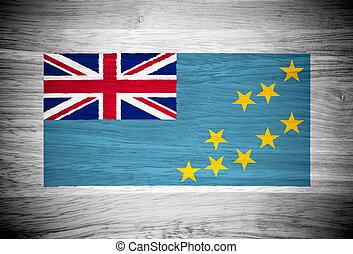 Tuvalu flag on wood texture