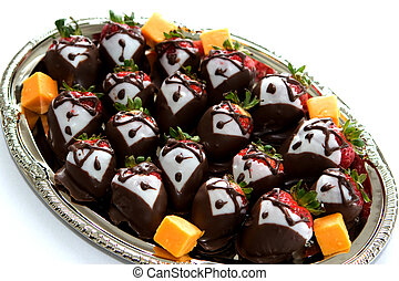Tuxedo Dressed Strawberries - A platter of strawberries are...