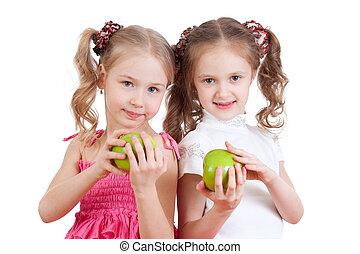 två flickor, med, grönt äpple, frisk mat