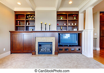 TV and entertainment center with white wood ceiling in a luxury room.