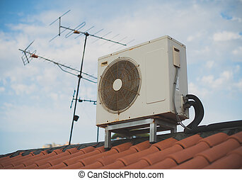 TV antenna and air conditioning on the roof of the old...