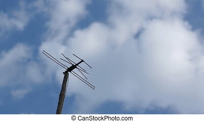 TV Antenna and sky with clouds