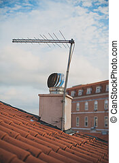 TV antenna and ventilation on the roof of the old house.