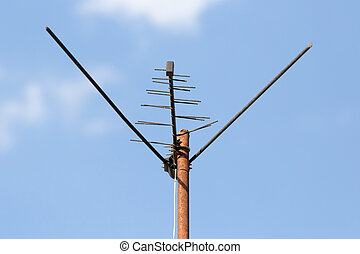 TV antenna on a background of blue sky .