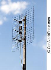TV antenna on a background of blue sky