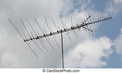 TV antenna. - TV antenna with clouds moving.