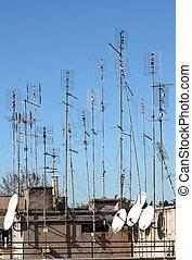 TV antennas - Many home TV antennas mounted on a roof