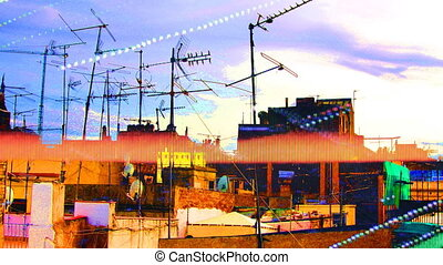 tv ariels on rooftops with clouds in background, barcelona,...