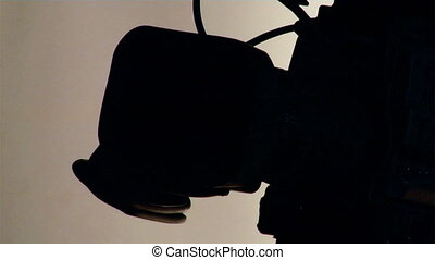 tv camera - close-up dv-cam camcorder light in from dark