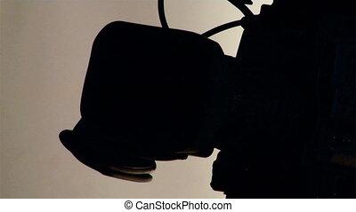 close-up dv-cam camcorder light in from dark