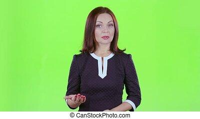 TV host tells the news program. Green screen
