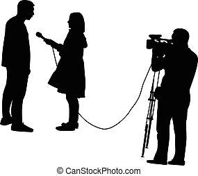 tv interview - TV host interviewing a man, a cameraman in...
