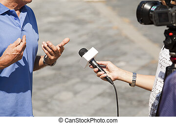 TV interview - A journalist is making a interview with a...