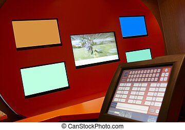 TV monitors in a bookmaking firm and bets copy space