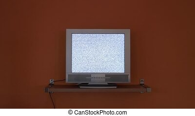 TV no signal - LCD TV against orange wall