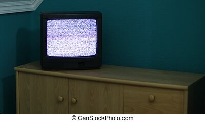 TV no signal - Static noise on a small TV set in a dim room