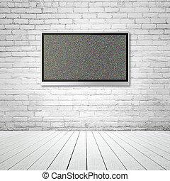 TV on brick wall