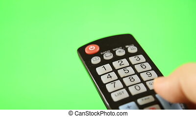 TV remote control isolated on green screen