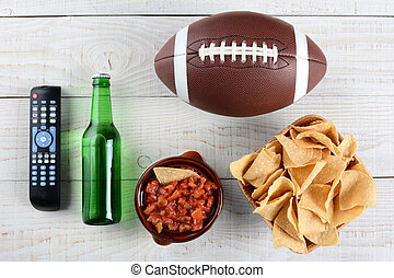 TV Remote, Salsa, Beer, Chips and Football