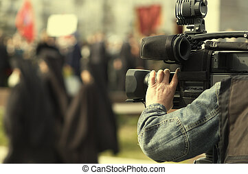 tv reportage - news cameraman