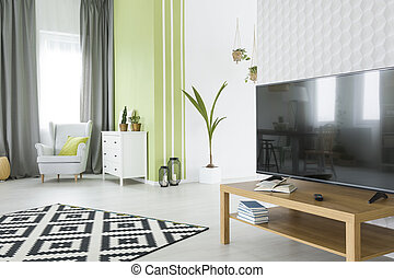 Tv room with 3d wallpaper
