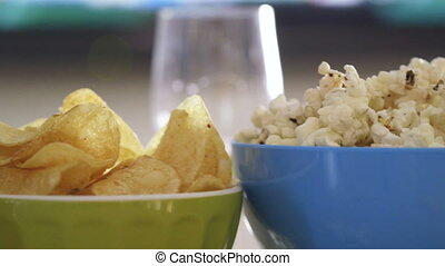 TV, Snacks and Beer - Pan of snacks and drinks in front of a...