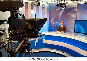 TV Studio - Reporter presenting news in TV studio - Focus on...