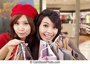 twee, vrolijke , meiden, in, een, winkelcentrum