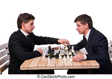 tweeling, broers, spelend schaakspel, vrijstaand, op wit