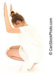 Tween Girl Hiding Against White Wall
