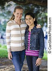 Tween Girlfriends - Portrait of Smiling Tween Girls arm in...