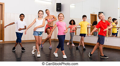 Tweens dancing with coach in choreography class - Group of ...