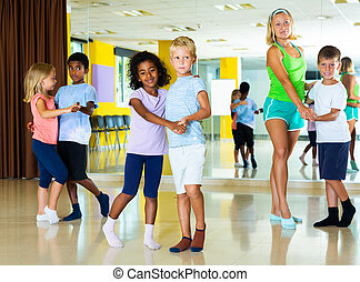 Tweens in pairs learning to dance waltz - Happy little ...
