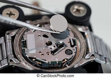Tweezers With Battery And Wrist Watch - Close-up Of Tweezers...